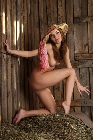 Nude beauty in the hayloft  photo