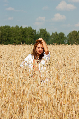 Young  woman of rye   Girl in the field  photo
