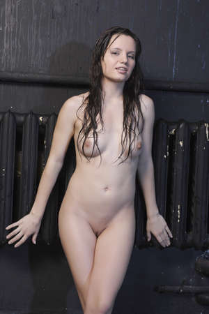 tits: Nude girl. Portrait of a wet woman. Stock Photo