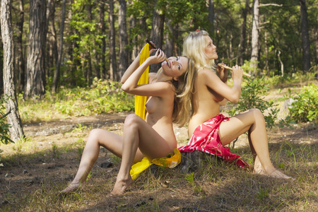 nude adult: Two lovely nymphs posing undressed outdoors. Stock Photo