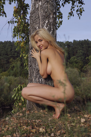 Girl topless outdoors. Portrait of a naked woman. Stock Photo