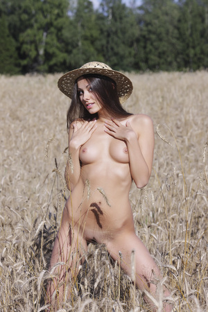 Naked girl on the field . Nude woman in nature. Stock Photo