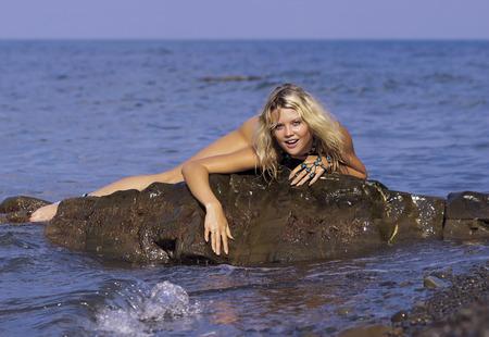 Nude in the sea. photo