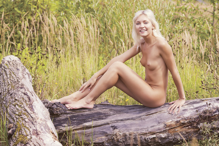 nude outdoors: Portrait of a young naked woman.