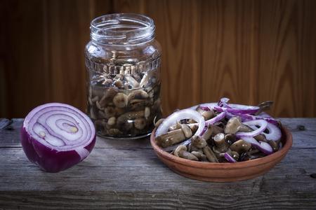 Pickles. Marinated mushrooms.