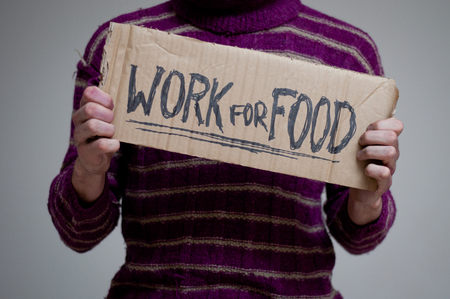 Woman holding a Cardboard written work for food photo