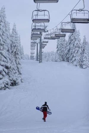 piste: lone snow boarder on piste