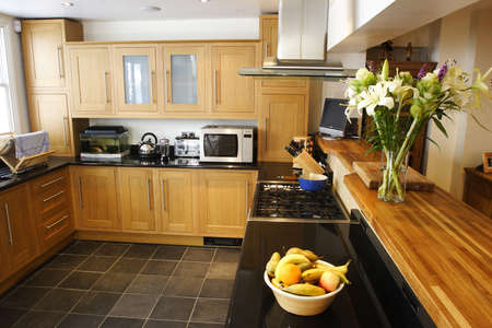 wooded fitted kitchen interior Stock Photo - 275519