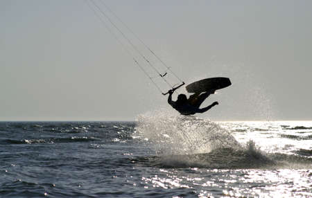 boarder: kite boarder jumping on the ocean