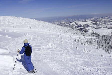 woman enjoying the skiing photo