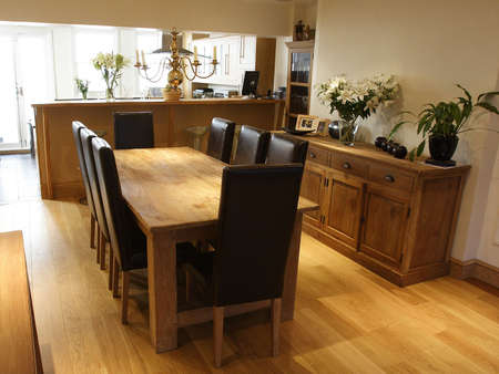 dinning area with oak flooring photo