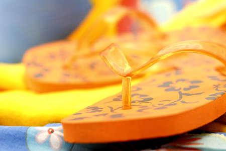 closeup of orange flip flops Stock Photo