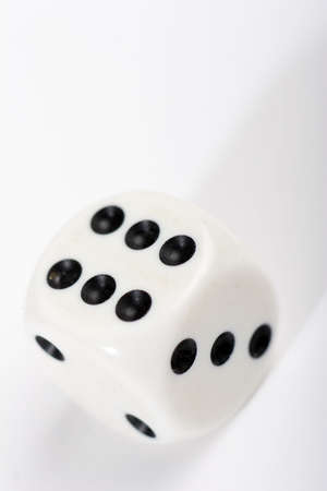 white dice on pale background Stock Photo
