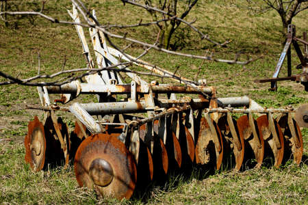 plough: old plough in field Stock Photo