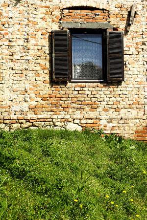 old window in brick wall photo