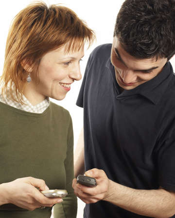 young couple using cell phones photo