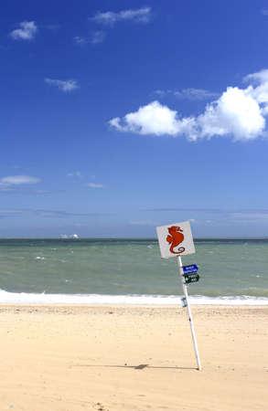 bygone: sign on beach
