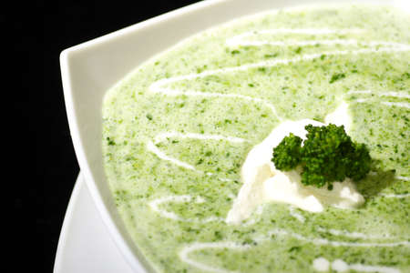close up photograph cream of broccoli soup