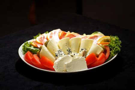 prosciutto: prosciutto ham with cheese and olive salad Stock Photo