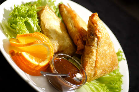 samosa with plum sauce and orange salad