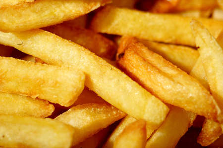 close up photograph of french frie or chips,