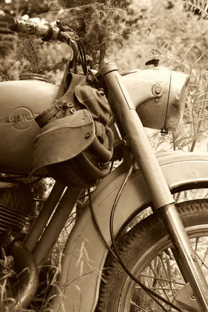 classic old motorcycle in parked in countryside