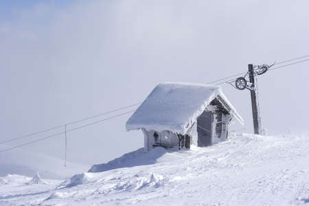 serbia xmas: ice covered snow shelter on mountain top Stock Photo