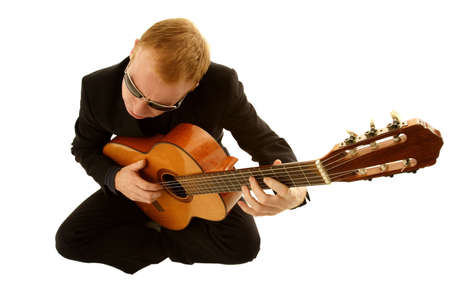 jamming: man playing a guitar isolated on white background