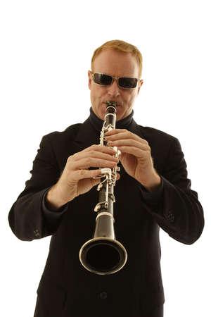 man playing clarinet isolated on white background