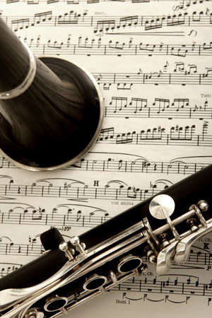 melodious: close up photograph of clarinet and sheet music Stock Photo