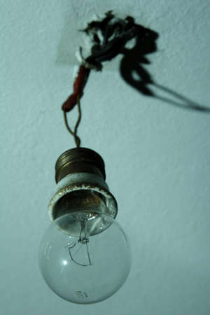 light bulb hanging from bare wires with shadow Stock Photo - 743696