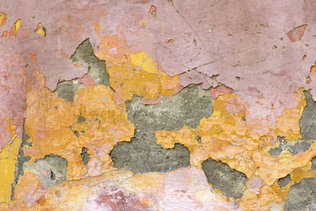 flaking: flaking plaster and paint on old wall