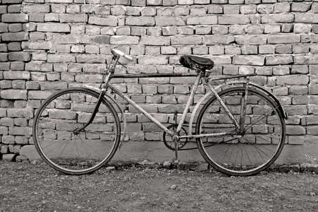 peddle: old retro bicycle leaning against a wall Stock Photo