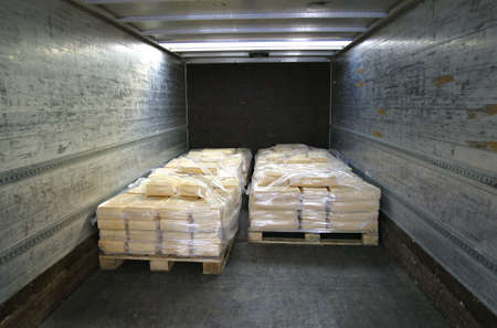 controlled: manufactured cheese on pallets in back of refridgerated truck
