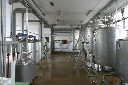 food storage: stainless steel pipes and tanks in dairy food production plant