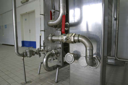 sterilized: pipes and pressure valves  in dairy produce factory
