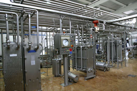 dairy: stainless steel temperature control valves and pipes  in modern dairy