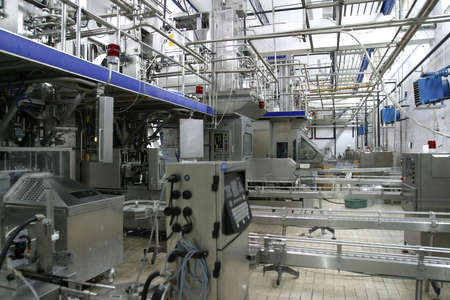 factory automation: stainless steel temperature control valves and pipes  in modern dairy