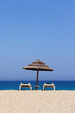 sun lounger on sandy beach, corsica, mediterranean Stock Photo - 1536039