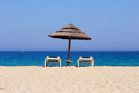sun lounger on empty sandy beach, corsica, mediterranean Stock Photo - 1536046
