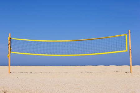 beach volleyball net on sandy beach, corsica, mediterranean photo