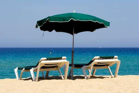 sun lounger on empty sandy beach, corsica, mediterranean Stock Photo - 1536045