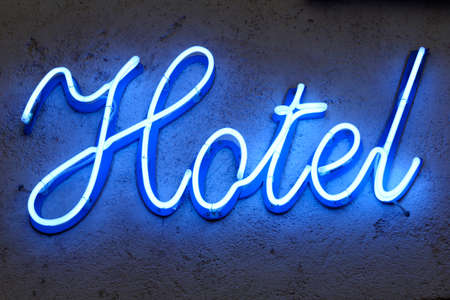 hotel sign: blue neon hotel sign, corsica, france Stock Photo