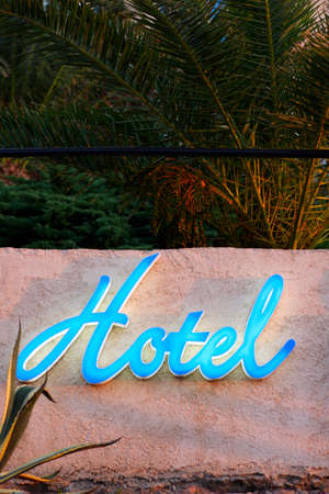 blue hotel sign on wall, corsica, france Stock Photo