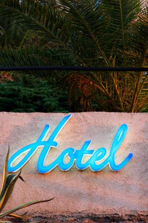 blue hotel sign on wall, corsica, france Standard-Bild
