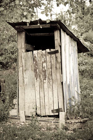 outhouse: tradtional wooden thunderbox outside toilet