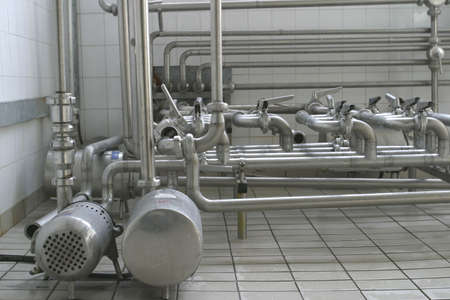 stainless steel pipes and valves in modern dairy photo