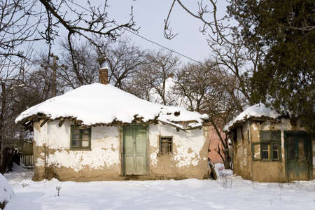 a traditional mud built farmhouse in winter photo