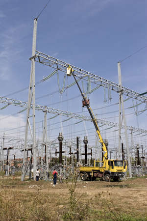 men repairing high voltage power lines photo