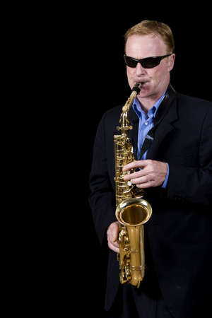 jazz musician playing saxophone photo